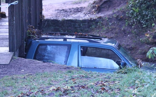 UK Flood Car Trapped under a bridge