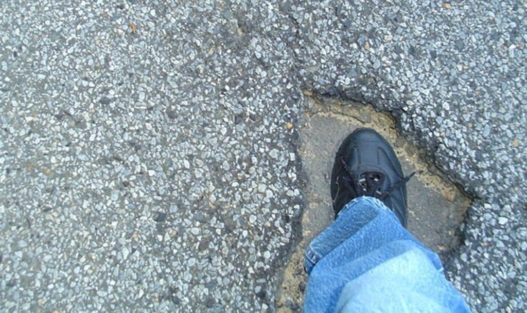 michigan auto insurance pothole
