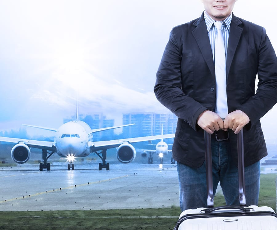 Travel insurance Young Man Luggage Staning In Front Of Air Plane