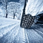 Car tires on winter road air pressure check