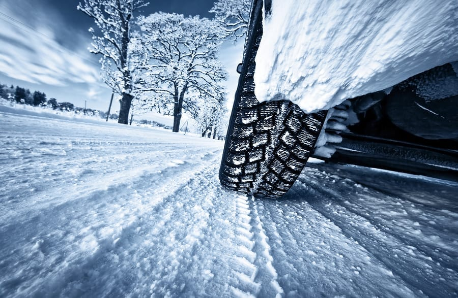 bigstock Car tires on winter road 103356746