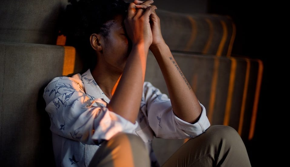 Mental health insurance claims - young woman stressed