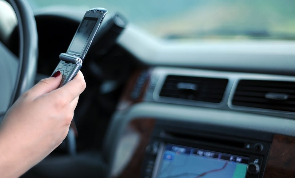 Distracted Drivers Pay More for Auto Insurance - Driver texting
