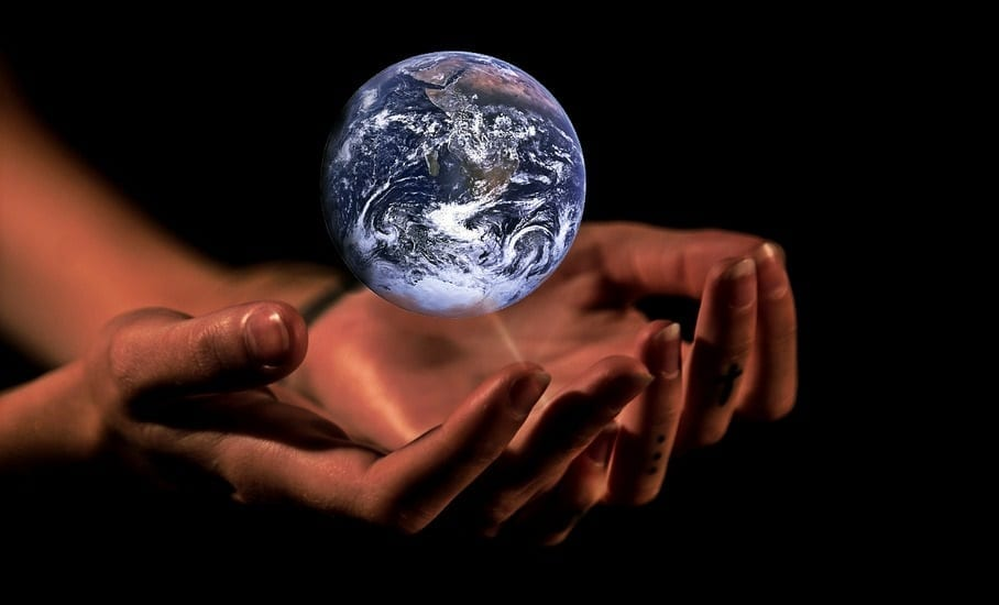 Climate Change effects - Hands - globe - world
