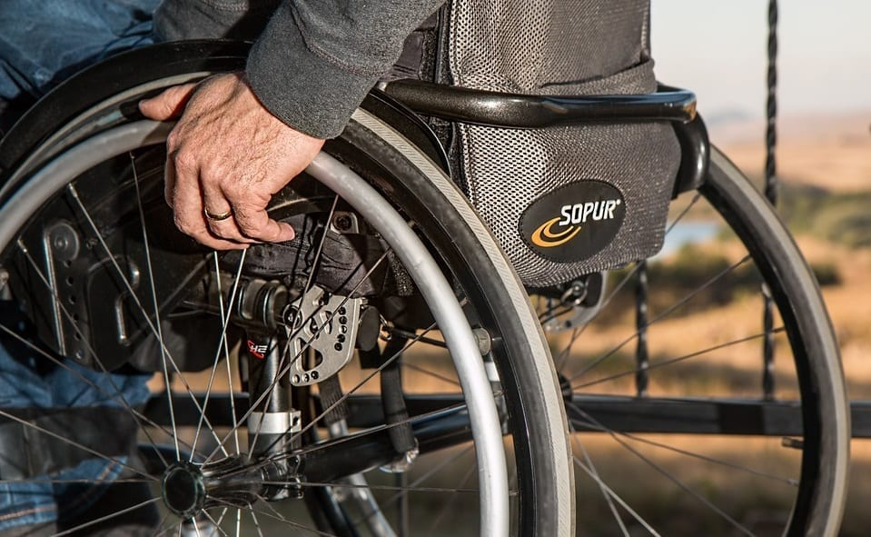 Colorado health insurance continues to protect those with pre-existing conditions - man in wheelchair