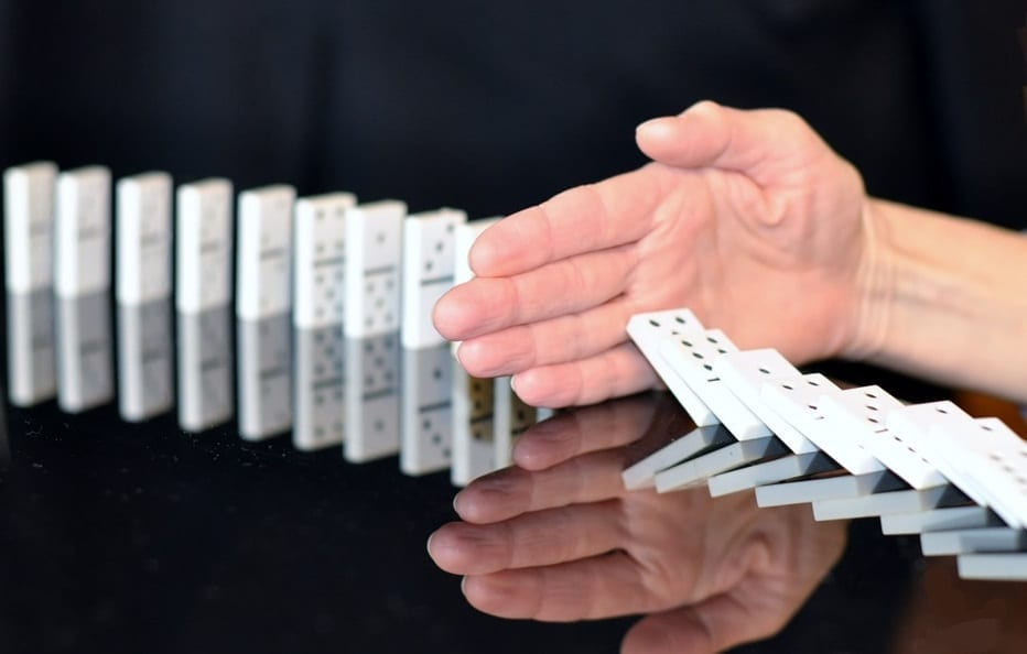 US Healthcare Groups - Opposed to Changes - Hand stopping dominoes