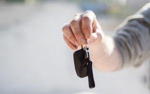 Cheaper auto insurance - Man holding car keys