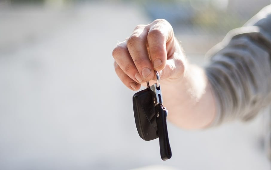 Cheaper auto insurance - Man holding car keys