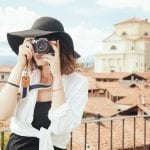 International Travel Insurance - Woman tourist taking photos
