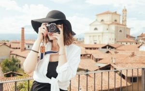 International Travel Insurance - Woman tourist taking photos