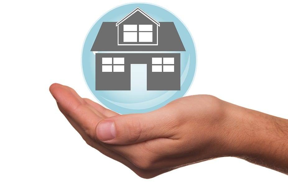 Homeowners insurance companies - Home in bubble over hand