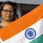 Indian health insurance - Woman holding Indian Flag