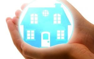 Home Safety Tips - Keeping Your Home Safe - Hands holding home