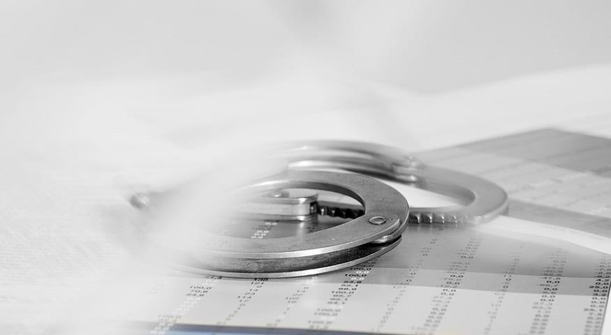 health insurance fraud - hand cuffs