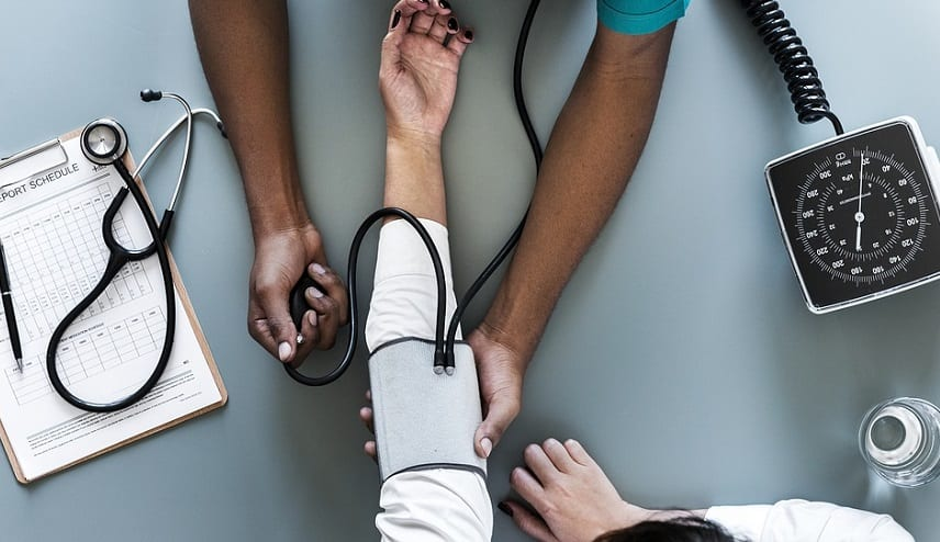 Long-term care insurance - Woman having blood pressure checked