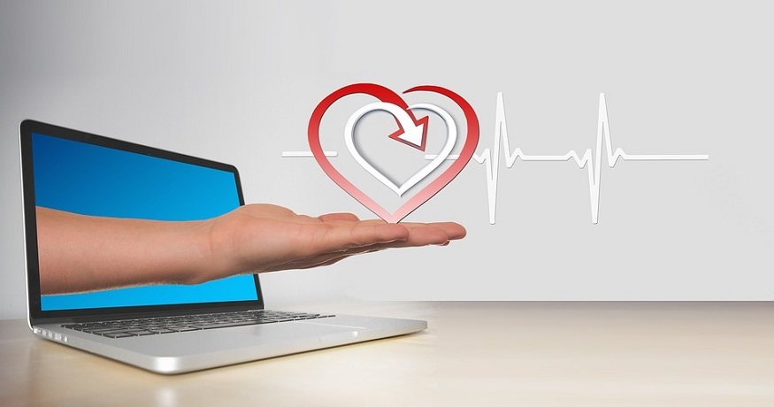 Health insurance exchange - Computer - heart - hand - heartbeat