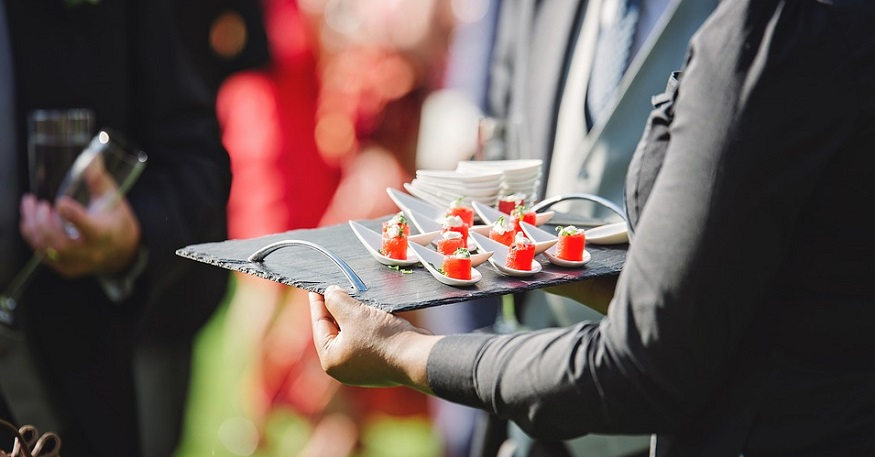 Catering Business Insurance - person serving food