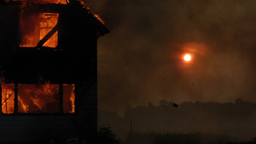 Comprehensive home insurance - house on fire