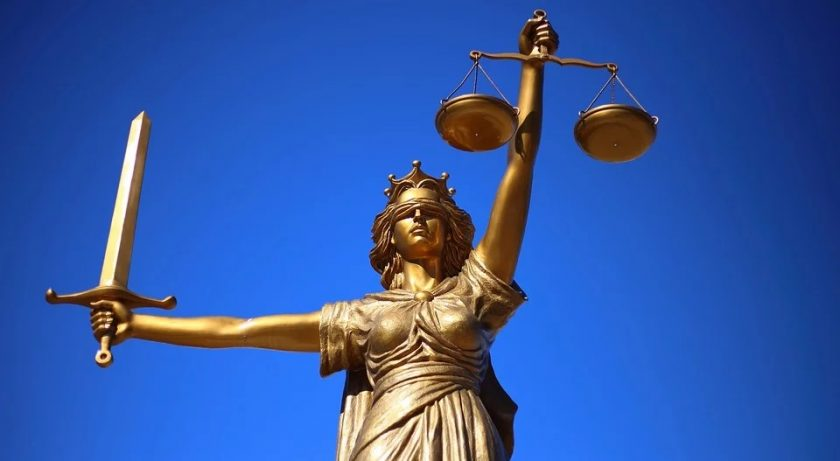 Proof of health insurance - Lady Justice