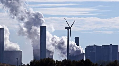 US Insurance Industry - Power plant and wind turbine
