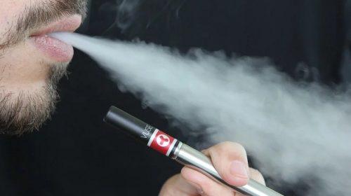 Vaping cessation - Person using E-cigarette - vaping