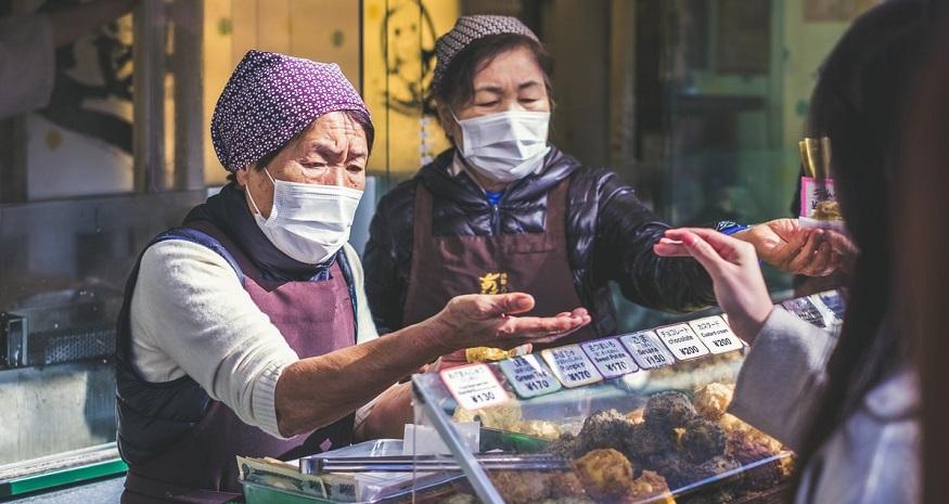 Coronavirus insurance losses - vendors wearing masks
