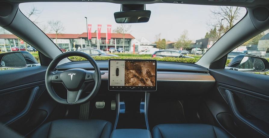 Autonomous vehicle safety regulations - Inside of Tesla car