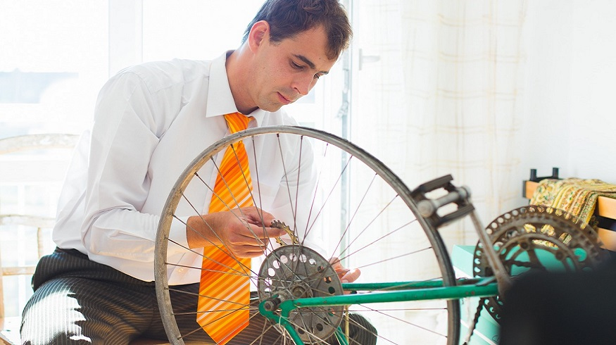 Bicycle Repair Business Insurance - Man repairing bike