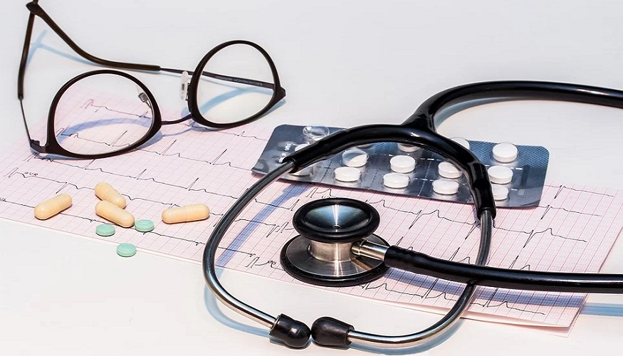 Employer sponsored health insurance - stethoscope - heartbeat monitor - glasses - pills