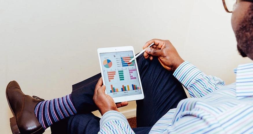 Job-based health insurance - Man studying graph on tablet