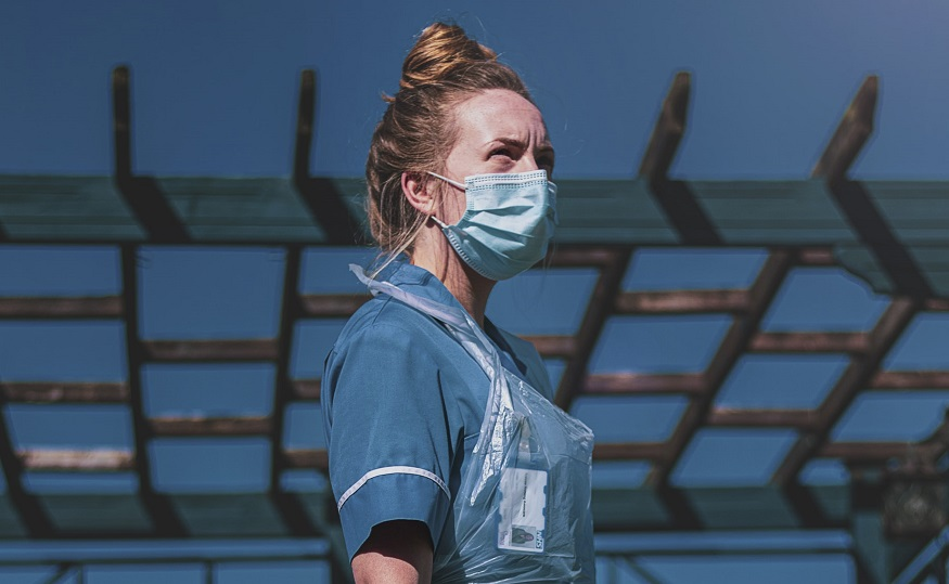COVID-19 dependent benefits -nurse wearing mask