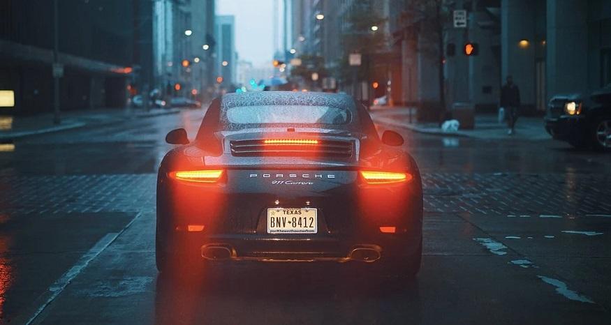 Progressive auto insurance - Porsche car with break lights on