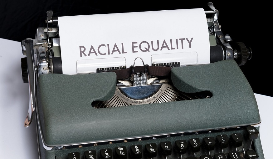 Insurance industry racism - racial equality - typewriter