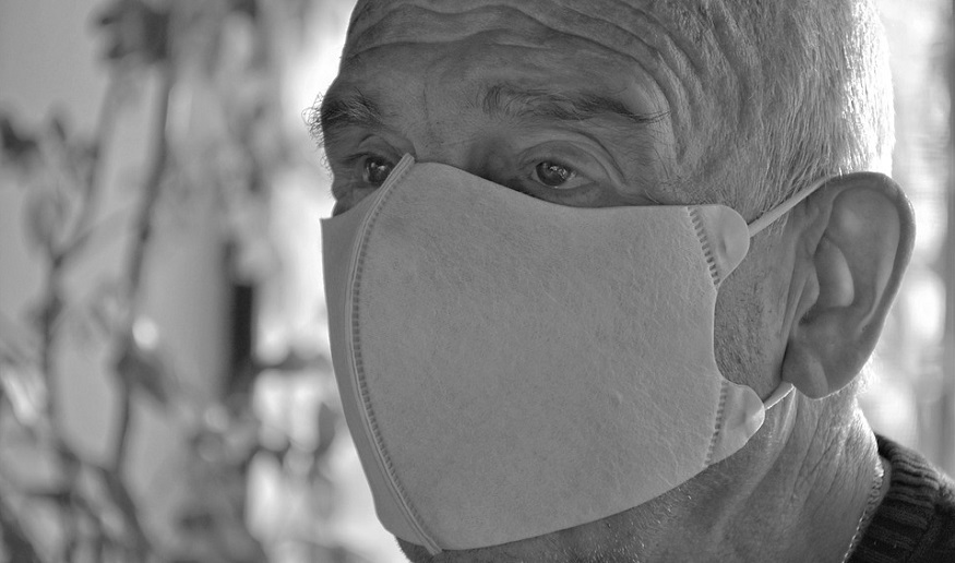 Life insurance coverage - COVID-19 - senior wearing mask