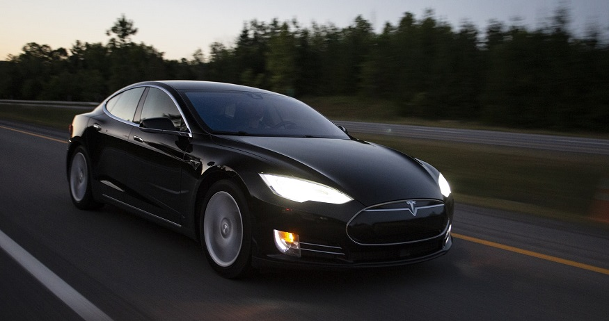 Tesla car insurance - Tesla vehicle on road