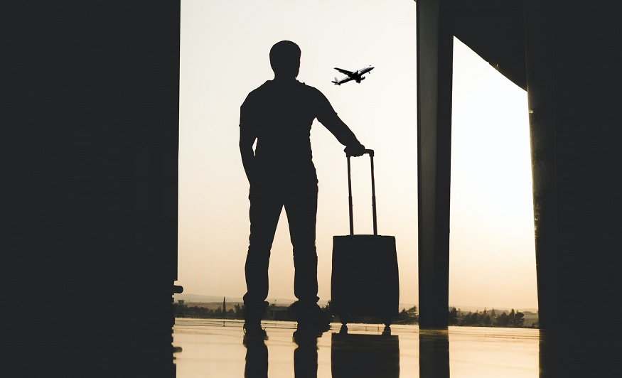 Travel insurance vs protection - person with luggage at airport