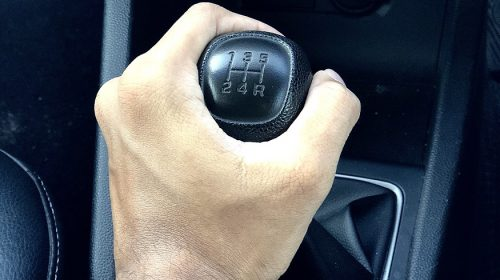 Allstate car insurance rates - hand on gear knob