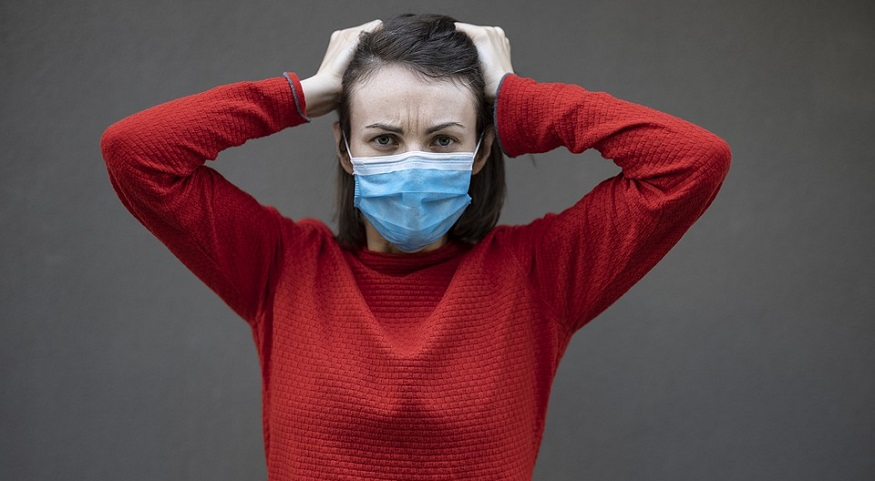 Lost health insurance - person wearing mask looking distressed