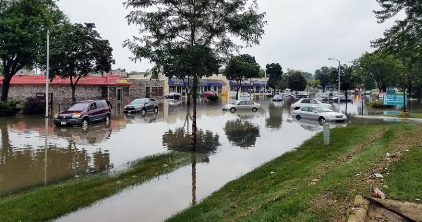 Increasing flood insurance rates - Flooding in neighborhood - shops & cars