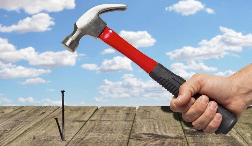 Insurance fraud - home repair - hammer and nail