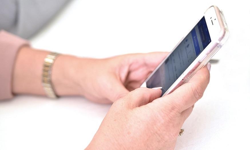 Mercury insurance app - person using mobile phone