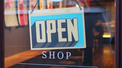 Small business insurance market - Open Sign on Shop Door