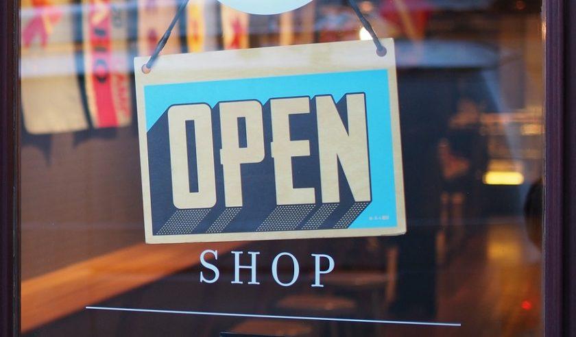 Small business insurance market - Open Sign on Shop Door