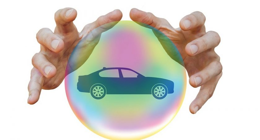 Auto insurance companies - hands - car in bubble
