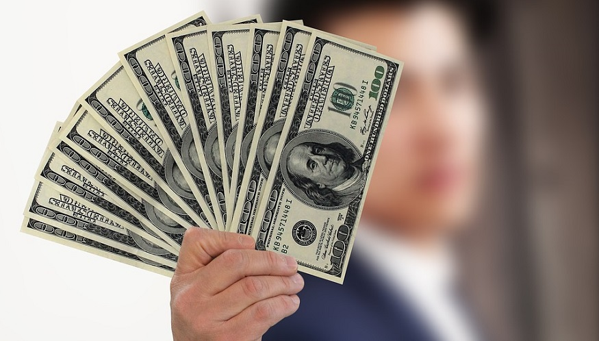 Underwriting profit - Person holding out cash