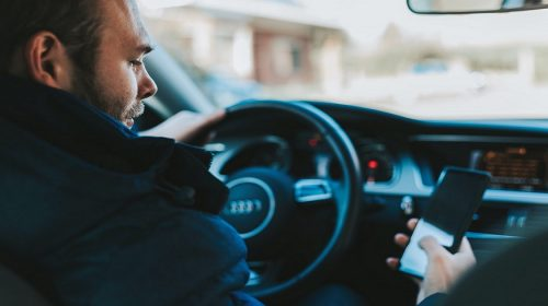 Distracted Driving Awareness Month - Man texting while driving