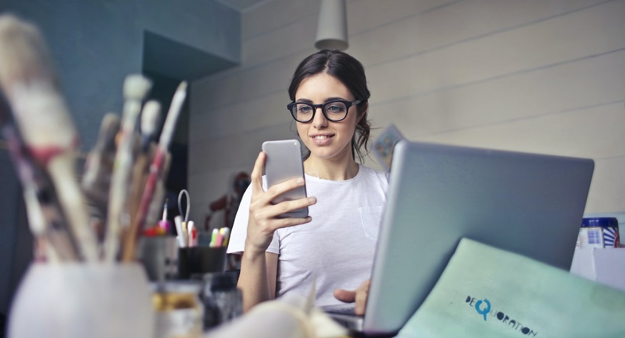 Insurance apps - young woman using mobile phone