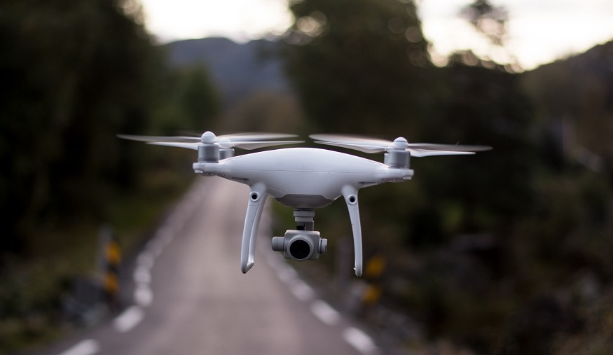 Insurance drones - drone flying over road