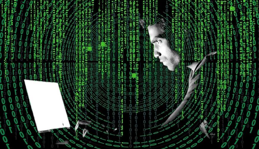 Unemployment fraud - man using computer - binary code - scam