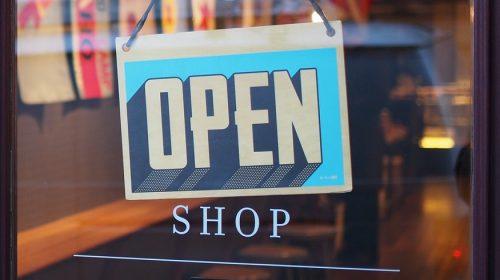 Business Owners Insurance - Open sign on shop door